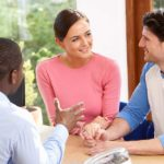 financial advisor working with a couple
