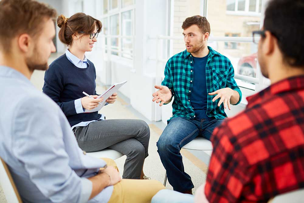 substance abuse counselor leading group therapy